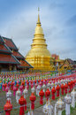 Golden pagoda with lantern foreground north of thailand wat phrathat hariphunchai temple lampoon thailand Stock Images