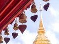 Golden pagoda of wat phra that doi suthep under cloudy blue sky bells at roof pavillion around in in chiangmai thailand Stock Photos