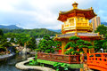 Golden pagoda in zen garden beautiful and tranquil with and waterfall the background Stock Photos