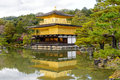 Golden Pavilion with reflections on water in red maple leave, au