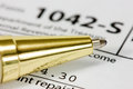 Golden pen on the tax form close up us Royalty Free Stock Image