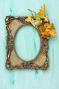 Golden picture frame autumn leaves blue background Royalty Free Stock Photo