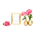Golden picture frame pink peony flowers. Minimal decoration Royalty Free Stock Photo
