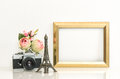 Golden picture frame, rose flowers and vintage camera. Paris tra