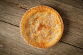Golden Pie on Rustic Barnwood Royalty Free Stock Images