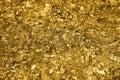 Golden pieces and sequins textured background