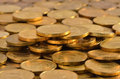 Golden piles of coins Royalty Free Stock Photos