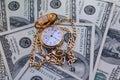 golden pocket watch on Hundred Dollars Royalty Free Stock Photo