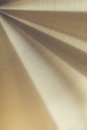 The golden polished metal surface. Royalty Free Stock Photo