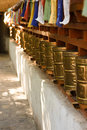 Golden prayer wheels, buddhist monastery. India Royalty Free Stock Photo
