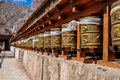 Golden prayer wheels a row of at alchi temple in ladakh india Royalty Free Stock Photo