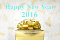Golden Present box with Happy New Year 2016 word at bokeh light Royalty Free Stock Photo