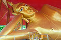 Golden reclining buddha Royalty Free Stock Images