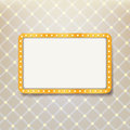 Golden retro frame with light bulbs on royal pattern background