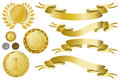 Golden ribbons, medallions and medal Stock Images