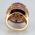 Golden ring with pink stone from back side Royalty Free Stock Photo