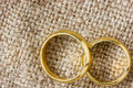 Golden rings on the burlap Stock Photo