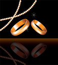 Golden rings and pearl beads Royalty Free Stock Photos