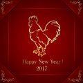 Golden rooster on red background
