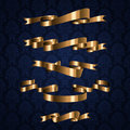 Golden royal design ribbon element on blue pattern Stock Photography