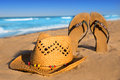 Golden sand beach with summer hat and sandals Stock Image