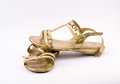 Golden sandals on a white background Royalty Free Stock Images
