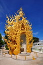 Golden sculpture at Wat Rong Khun temple Stock Photos