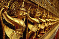 Golden sculptures in the golden palace in bangkok Royalty Free Stock Photos