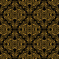 Golden seamless damask pattern on black is presented Royalty Free Stock Images