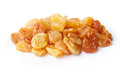 Golden seedless raisins natural from california dried treated grapes retouched large depth of field Royalty Free Stock Photos