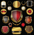 Golden shield, badges, labels and laurels Royalty Free Stock Photo