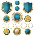 Golden shields labels and laurels blue edition illustration Royalty Free Stock Images