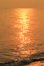 Golden shimmering sea water with wave sun light refection on sea Royalty Free Stock Photo