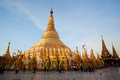 Golden shwedagon pagoda in yangon myanmar january burmese pilgrims on the trail around during shwesettaw festival on january Stock Photos