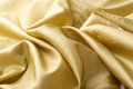 Golden silk background abstract textured Royalty Free Stock Images