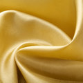 Golden silk background abstract textured Royalty Free Stock Photo