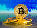 Golden and silver bitcoin on blue abstract finance background. Bitcoin cryptocurrency. Royalty Free Stock Photo