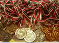 Golden, silver, bronze sports medal with red, white and green ribbon. Winner awards