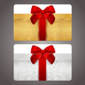 Golden and silver gift card discount card with gift box and red bow ribbons this background design usable for gift coupon voucher Royalty Free Stock Image