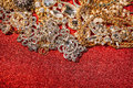 Golden and silver jewelry on red shiny glitter background Royalty Free Stock Photo