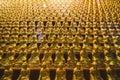 Golden Small Buddha Statues inside Yakcheonsa Temple. Jeju, South Korea