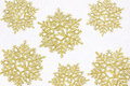 Golden snow flakes with glittering white background. Christmas t Royalty Free Stock Photo