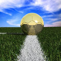 Golden soccer ball in the grass Stock Photos