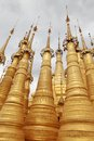 Golden spires of buddhist temple myanmar Royalty Free Stock Photos