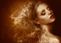 Golden Splatter. Woman with Bronzed Painted Skin. Fantasy Royalty Free Stock Photo