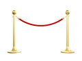 Golden stanchion fence with red barrier rope isolated on white background Royalty Free Stock Photography
