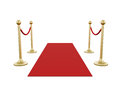 Golden stanchion and red carpet fence with barrier rope isolated on white background Royalty Free Stock Photo