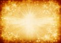 Golden star background with vibrant light Stock Photos