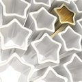 Golden star among white ones as festive background Royalty Free Stock Photo