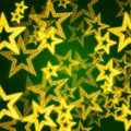 Golden stars in green background Royalty Free Stock Images